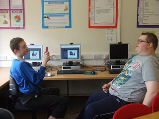 Two children using computer-aided video communication to help build confidence in communication